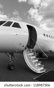 ladder private jet and red carpet on ground