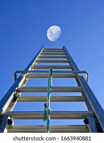 Ladder reaching up to the moon motivation concept