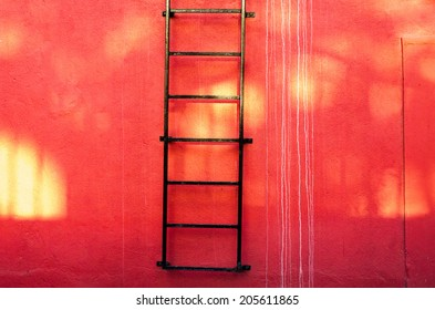 ladder and red wall
