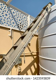 ladder resting against a tank - concept for water tank cleaning