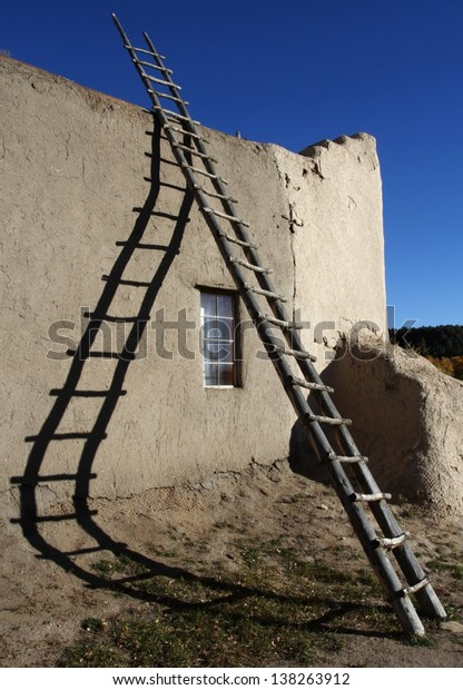 Ladder and Shadow at San Lorenzo Church in Picuris Pueblo, New Mexico