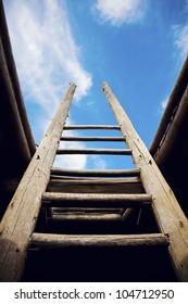 Ladder - the symbol of the career steps against blue sky