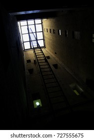 Ladder in a tower walking to the ceiling window, vertical image