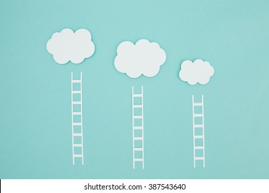 Ladders to climb onto your cloud. Conceptual paper craft image about cloud computing and themes about promotion.