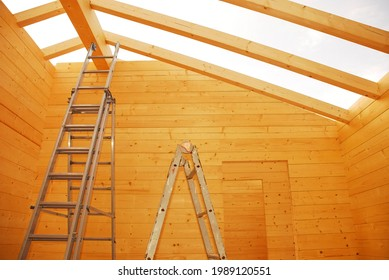 Ladders and empty door frames in a partially constructed wood (fir) block house, a pre-cut wooden house which is assembled on-site in Italy