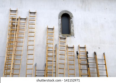 Ladders leaning against the wall of a church