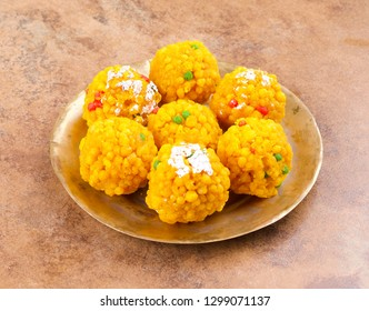 Laddu also know as laddoo, ladoo, laddo are ball-shaped sweets popular in the Indian festivals. Laddu are made of flour, minced dough and sugar with other ingredients.