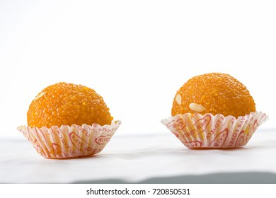 Laddu or laddoo are ball-shaped sweets popular in the Indian subcontinent. They are often served at festive or religious occasions.