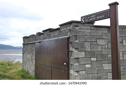 The Ladies Beach sign in English and Irish language in Blackrock, Dundalk County Louth directing visitors to a beach with vanity walls.