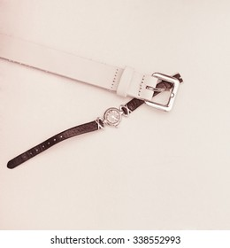 ladies belt and gold watch