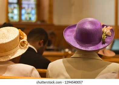 ladies in church wearing colorful hats