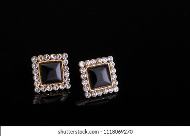 Ladies ear studs with precious stones