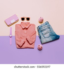 Ladies Fashion Clothes and Accessories. Purse, watches, sunglasses. Pink shirt and jeans. Pastel colors Trend Minimal Summer