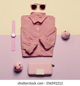 Ladies Fashion Clothes and Accessories. Purse, watches, sunglasses. Pink shirt. Pastel colors Trend Minimal Summer