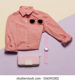 Ladies Fashion Clothes and Accessories. Purse, watches, sunglasses. Pink shirt Pastel colors Trend Minimal Summer