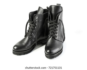 Ladies fashion leather shoes for autumn, spring, European winter. Boots for a modern grunge woman. Women's black boots with laces isolated on white. Black Leather Boots. Autumn. Fashion. Style.
