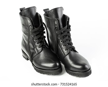 Ladies fashion leather shoes for autumn, spring, European winter. Boots for a modern grunge woman. Women's black boots with laces isolated on white. Black Leather Army Boots. Autumn. Fashion. Style.