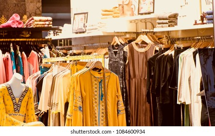 Ladies fashion wears are hanging inside a clothing stores isolated female dresses unique stock photo