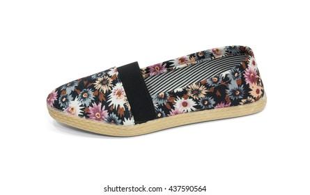Ladies flat black floral shoe on white background