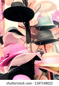 Ladies and gentlemen hats on a hat stand