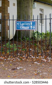 """Ladies, Gents"" Sign at cricket pavilion in the University Parks in Oxford"