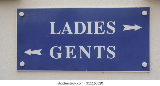 """Ladies, Gents"" Sign on Woolacombe Beach, on the North Coast of Devon, England, UK"