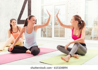 Ladies giving high five at gym
