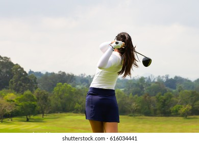 Ladies golfer finished golf swing.