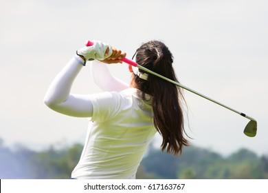 Ladies golfer finished golf swing.