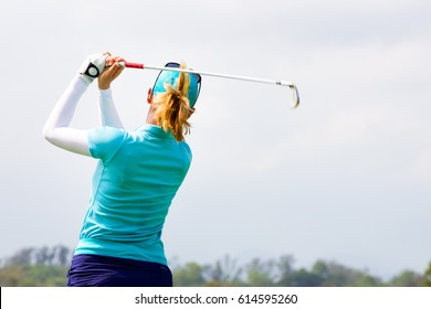 Ladies golfers are finished swing.