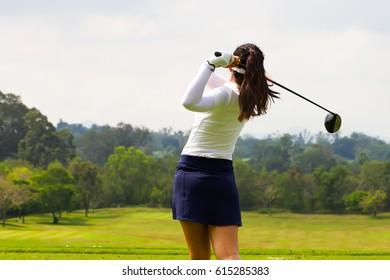 Ladies golfers finished swing.
