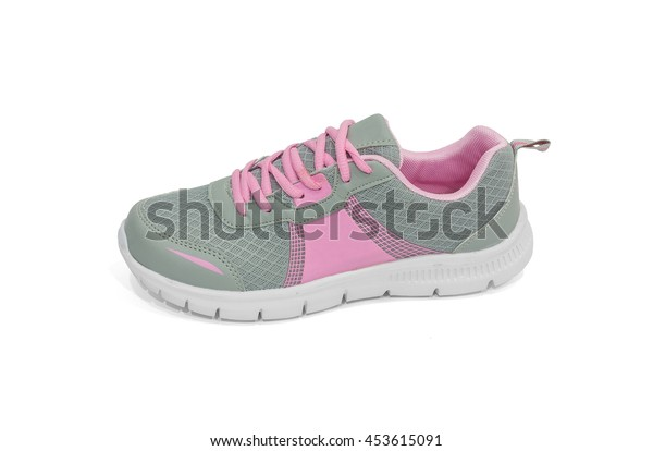 Ladies gray and pink running shoes on white background