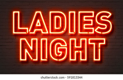Ladies night neon sign on brick wall background