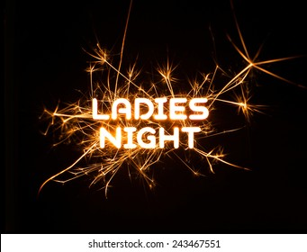 LADIES NIGHT word in glowing sparkler on dark background.