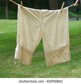 ladies pantaloons hanging from clothesline