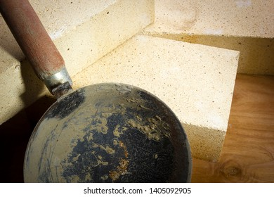 Ladle mortar and refractory bricks on a wooden surface