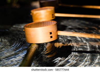 Ladles used to scoop the water when cleansing yourself before entering a Shinto a shrine. These ones are perched outside a shrine in Kagurazaka.