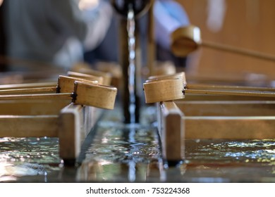 Ladles and Water at the entrance of a shrine in Japan.