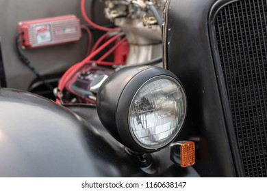 Ladner, British Columbia / Canada - August 19th 2018 - A Hotrod's front light and Grill at An Annual Car Show.