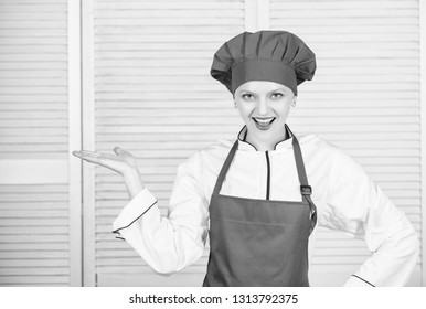 Lady adorable chef teach culinary arts. Improve culinary skill. Welcome to my culinary show. Woman pretty chef wear hat and apron. Uniform for professional chef. Best culinary recipes to try at home.
