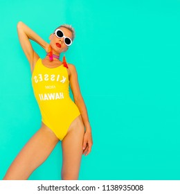 Lady Beach tropical fashion look. Stylish swimsuit and accessories