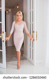 Lady in beige classical fashionable dress, woman elegant fashion