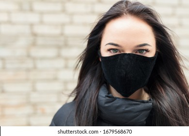 Lady with a black respirator mask.