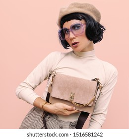 Lady brunette in stylish vintage clothing and accessories. Autumn fashion trends