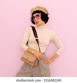 Lady brunette in stylish vintage clothing and accessories. Autumn trends