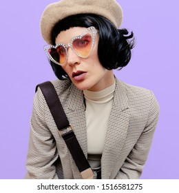 Lady brunette in stylish vintage clothing and accessories. Autumn fashion concept