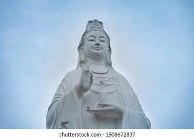 A Lady Buddha Da Nang statue with blue sky at Linh Ung Pagoda on Son Tra Peninsula in Da Nang, Vietname.