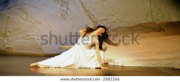 lady dancing during the pina bausch performance on stage