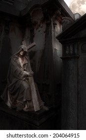 Lady death statue from an old european cemetery in a full moon night