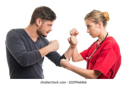 Lady doctor and male patient in fighting position holding fists isolated on white background